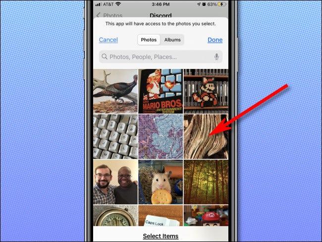 حدد الصور لمنح الوصول إلى التطبيق